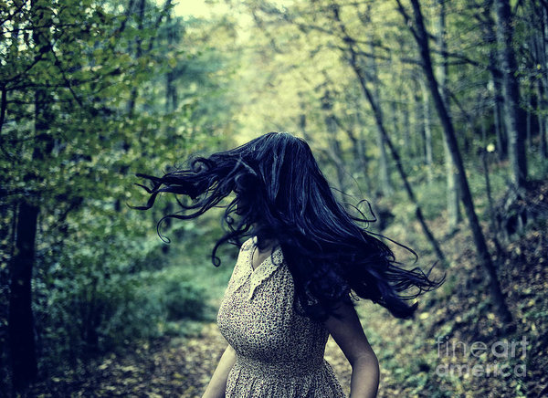 scared-girl-running-in-the-forest-catalin-petolea